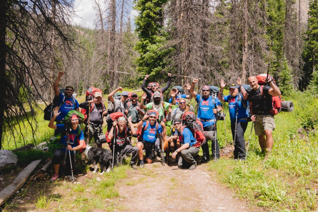 a group of no barriers warriors taking a group photo after hiking