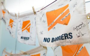 No Barriers Flags hanging up at No Barriers headquarters in Fort Collins Colorado