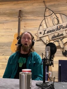 Josh Blue at the microphone. Behind the scenes during the podcast recording.