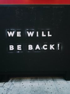 "Sign saying ""we will be back"""