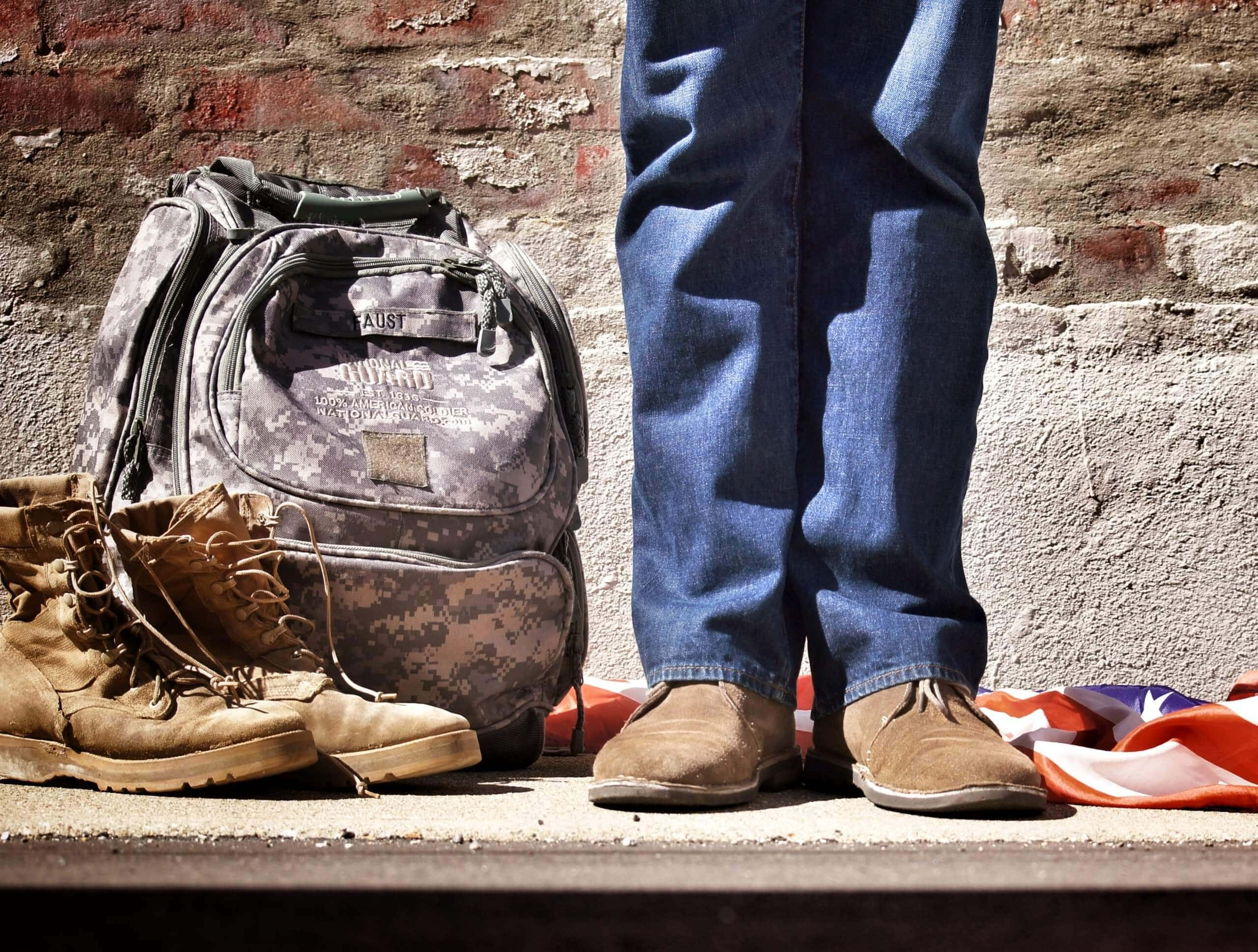 Military boots, backpack and feet