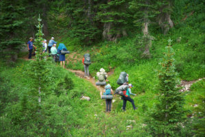 group hiking up a trail